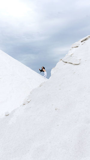 Man standing on snow against sky