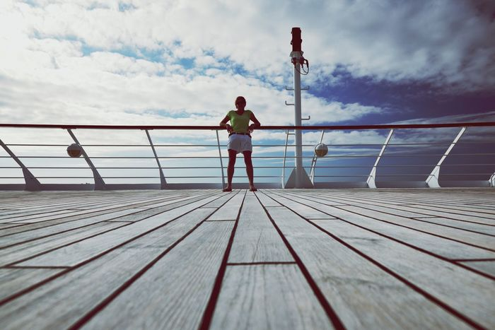 Adventure on a cruise On Board On The Ocean Holiday Vacation Cruising Cruise Sky Railing Real People One Person Full Length Cloud - Sky Water Leisure Activity Lifestyles Nature Sea