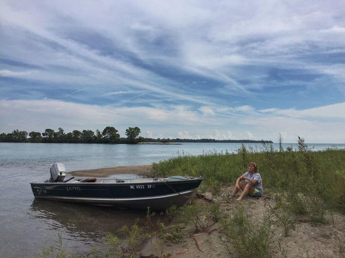Enjoying the beach at Sugar Island Boating Detroit River Michigan Summer Boating Time Hangingout On The Beach Sugar Island Riverside Photography Small Boat Beached Boat Relaxing Moments Relaxing Enjoying Nature Enjoying The Moment