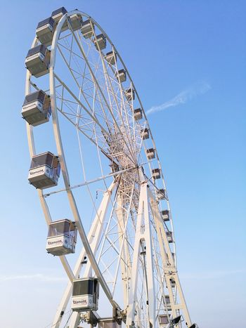 EyeEm Selects City Ferris Wheel Amusement Park Ride Arts Culture And Entertainment Amusement Park Rollercoaster Traveling Carnival Sky Big Wheel Visiting First Eyeem Photo