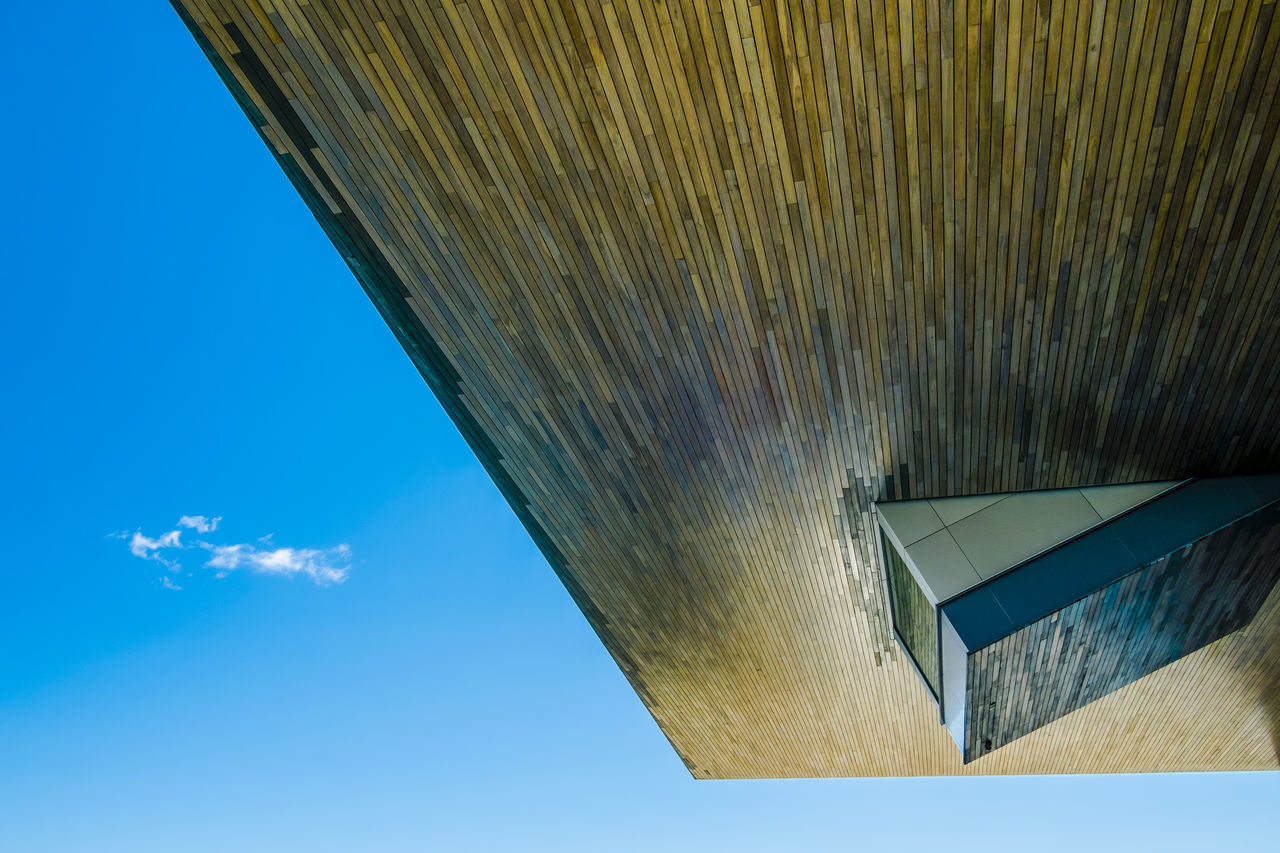 low angle view, built structure, sky, architecture, blue, day, pattern, outdoors, building exterior, no people, close-up