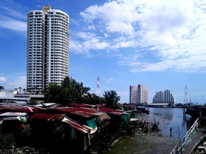 Slum by buildings against sky