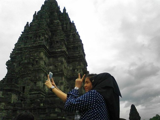 Mobile Conversations selfie.. Portrait People Adults Only Prambanan Temple Women Taking Photos Religion Spirituality Backgrounds First Eyeem Photo Travel Destinations Sky Real People Architecture Yogyakarta,indonesia INDONESIA