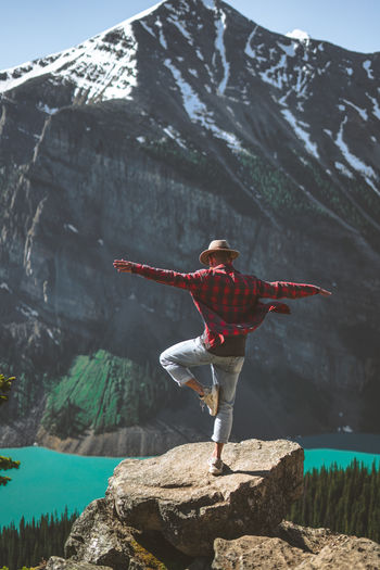 Banff National Park  Lake Louise,Alberta Arms Outstretched Arms Raised Beauty In Nature Day Full Length Human Arm Leisure Activity Lifestyles Limb Mountain Nature One Person Outdoors Real People Red Scenics - Nature Standing Water Winter Women