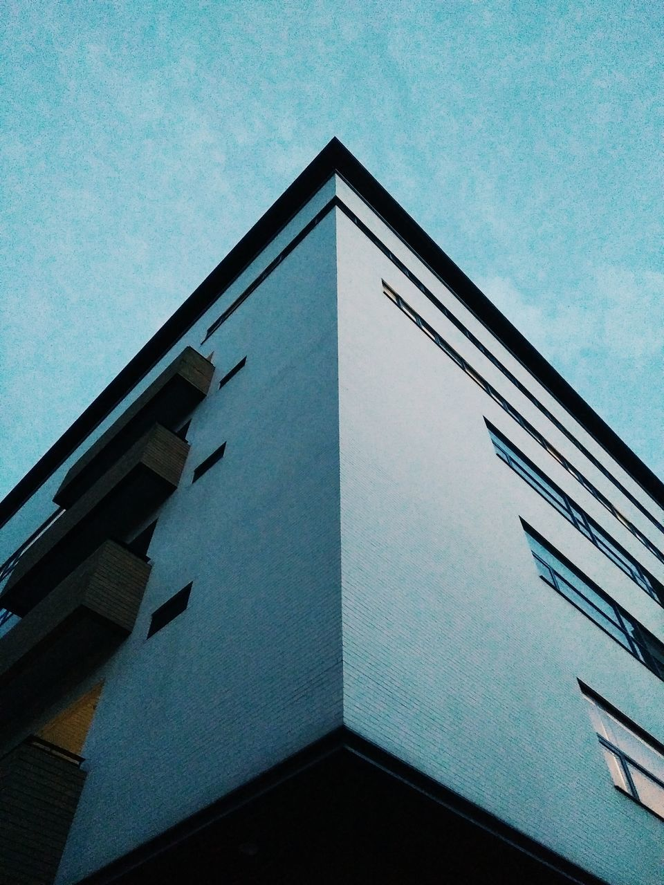 low angle view, architecture, built structure, building exterior, day, outdoors, no people, sky, window