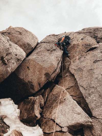 Midsection of person on rock