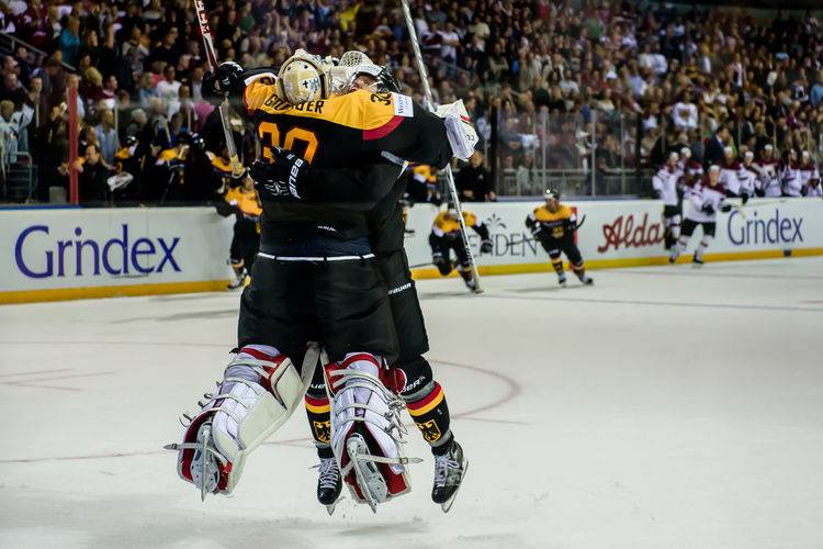 Christian Ehrhoff has announced that, he decides to end his professional hockey player career. At this photo he celebrates win with his teammate Philipp Grubauer. (PyeongChang 2018 Qualification against team Latvia) Athlete Christian Ehrhoff Deutsche Emotions European  German Goalie Latvia Philipp Grubauer Photojournalism Riga Action Crowd Goaltender Hockey Ice Hockey News Olympics Qualification Professional Sport Real People Reportage Sport