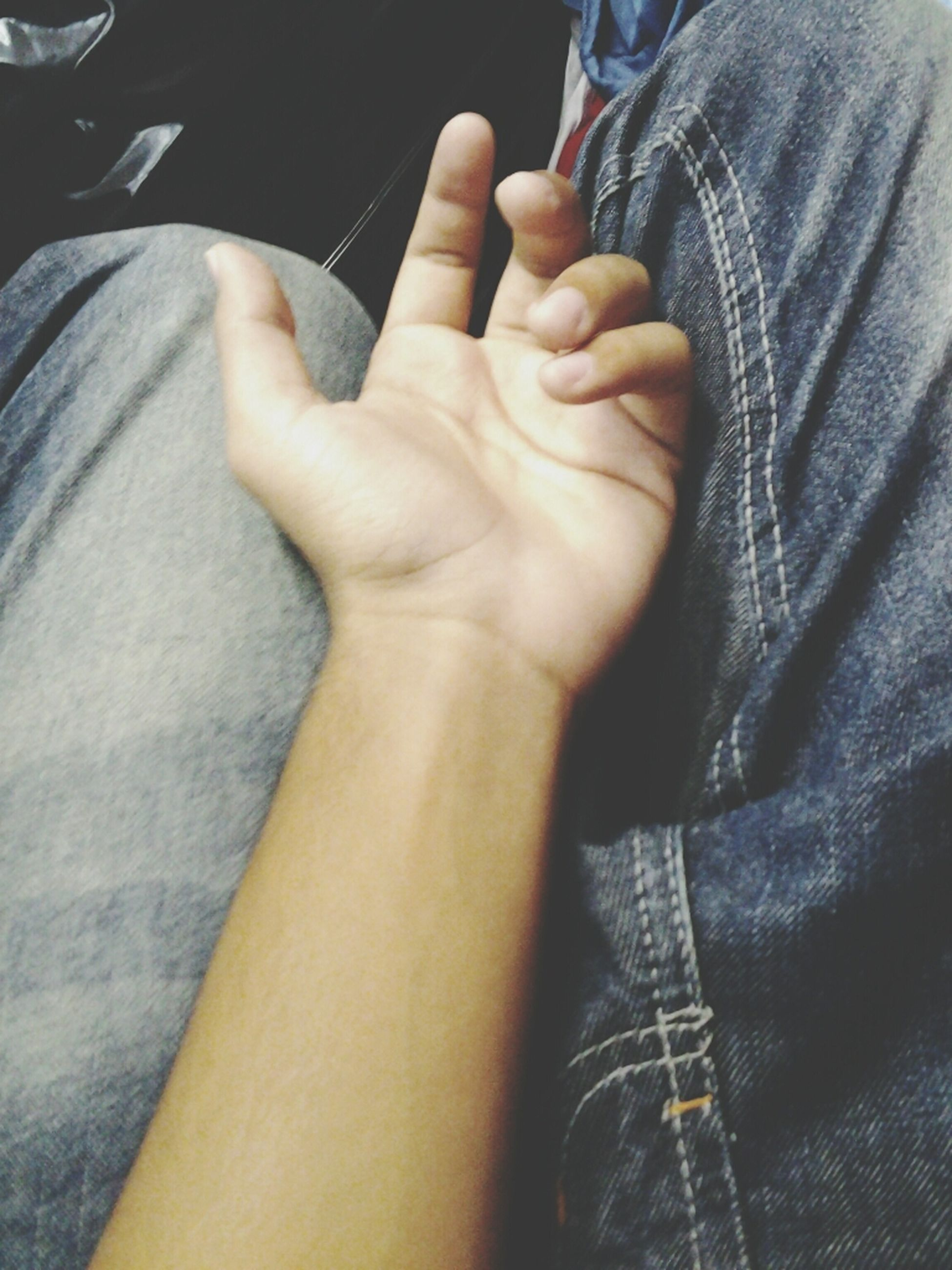 person, part of, lifestyles, indoors, men, human finger, midsection, close-up, low section, leisure activity, cropped, holding, personal perspective, jeans