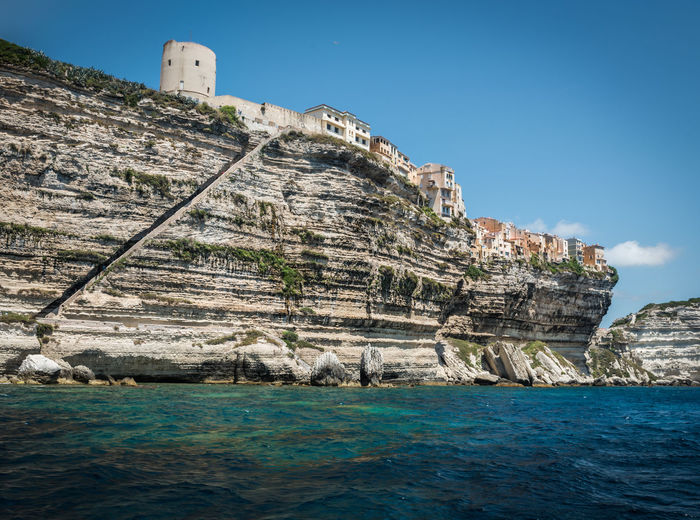Living on the edge Cliffs Edge Mediterranean Sea Stairs Steps Architecture Blue Built Structure Cliff Coast Corsica Day Rock Rocks Sea Steep Summer Tourism Travel Destinations Vacation Water