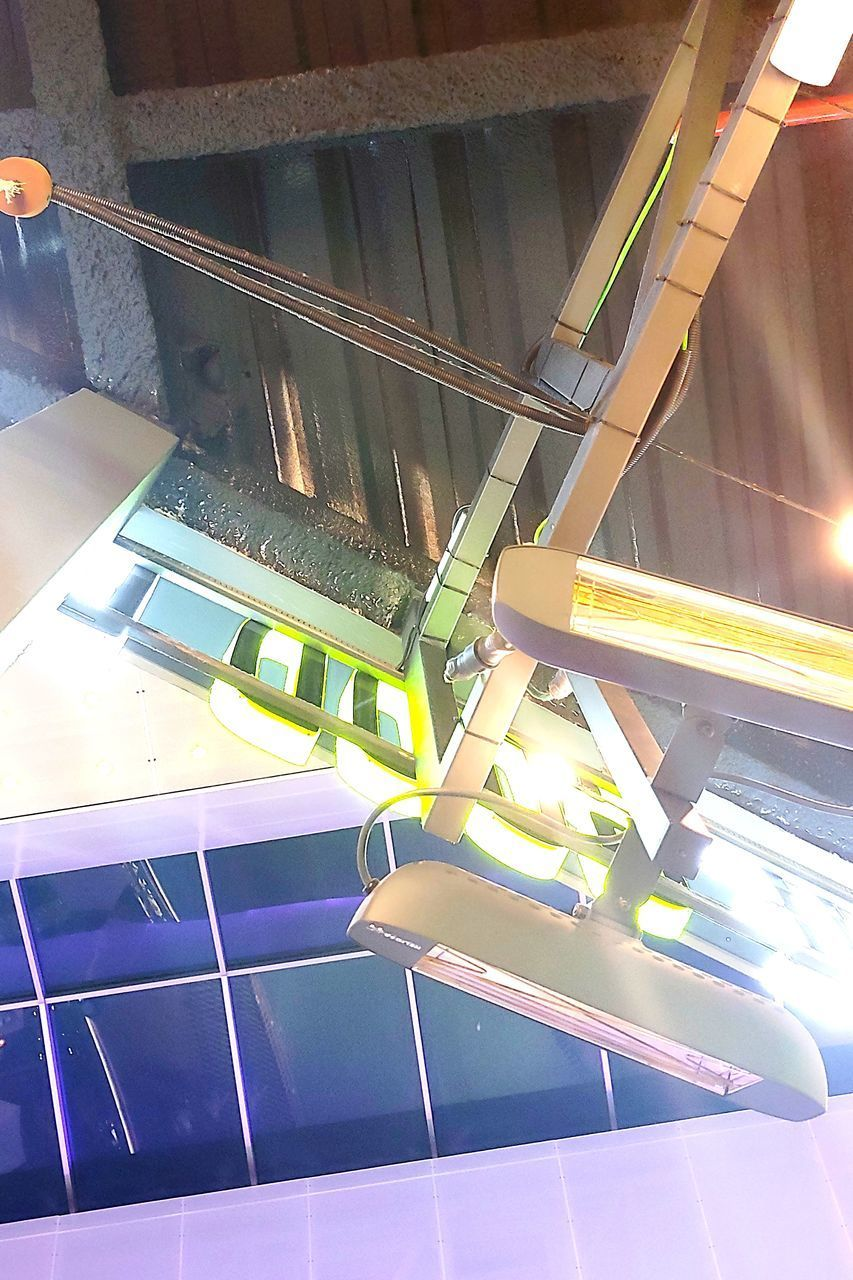 indoors, no people, illuminated, technology, staircase, high angle view, glass - material, modern, railing, architecture, metal, reflection, sunlight, machinery, connection, number, convenience, day, transportation