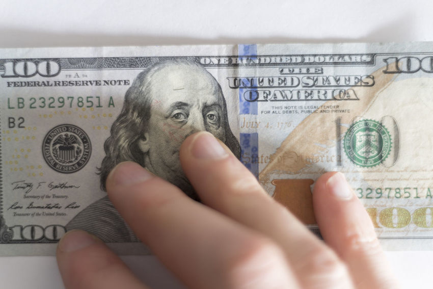 Hand on one hundred dollar bill 100 Dollar Bills American Benjamin Franklin Bills Bitcoin Buying Cash Compensation Currency Digital Fraud Management One Hundred Pay Payday Payment Salary Selling Tax Wages Wallet Wealth