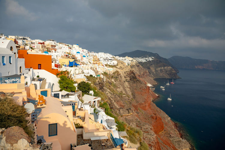 Greece Santorini Oia Thira Architecture Building Exterior Built Structure Building Sky Residential District Water Cloud - Sky Mountain City Sea Nature Day Town House No People High Angle View Outdoors Beauty In Nature TOWNSCAPE