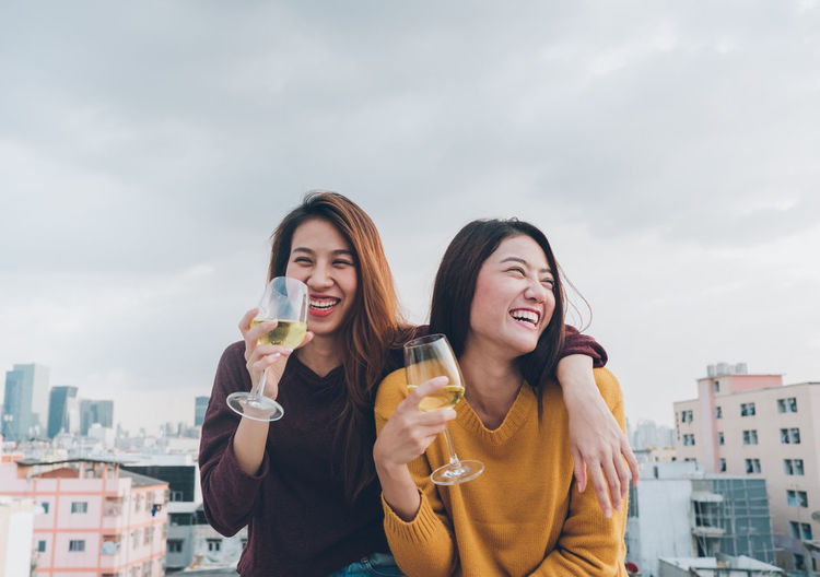 Happy asia girl friends enjoy laughing and cheerful sparkling wine glass at rooftop party,Holiday celebration festive,teeage lifestyle,freedom and fun.lesbian couple Asian  Celebration Champagne Friends Fun Rooftop Toast Casual Clothing Cheerful City Drinking Evening Food And Drink Friendship Happiness Leisure Activity Lesbian Lifestyles Smiling Sunset Togetherness Two People Urban Wine Young Women International Women's Day 2019
