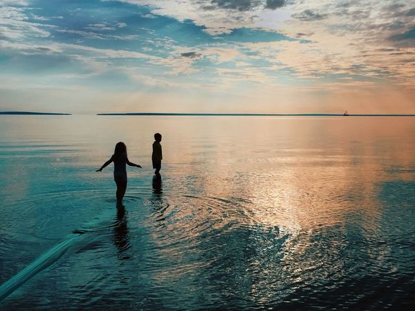 Stunning Sky Clouds Coral Blue Boy And Girl Beach No Screens Kids Playing At The Beach Sea Nature Leisure Activity Tranquility Tranquil Scene Waterfront Togetherness Vacations Beauty In Nature Sky