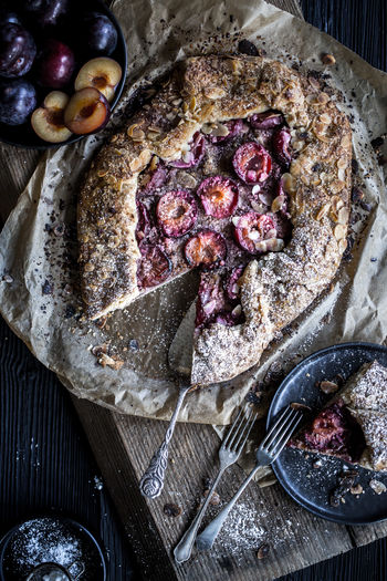 Baked Pastry Item Bowl Directly Above Eating Utensil Food Food And Drink Freshness Fruit Healthy Eating High Angle View Kitchen Utensil No People Piece Of Cake Plum Plum Galette Ready-to-eat SLICE Still Life Table Temptation Wellbeing Wood - Material