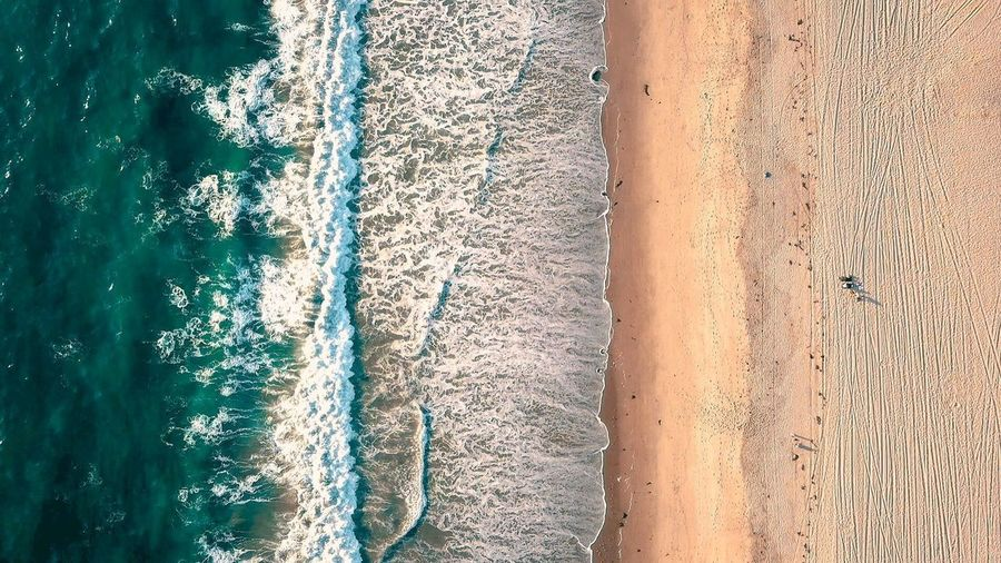 Drone Shot of Hermosa Beach, Birds eye Sand Sea Beach Wave Water Nature Beauty In Nature Outdoors Scenics Day Wake - Water Vacations No People Tranquil Scene
