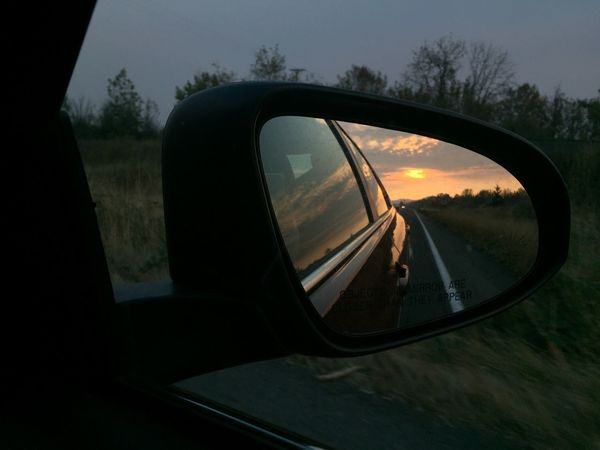 Mirrored sunset with trees Car Close-up Land Vehicle Mode Of Transport Nature No People Outdoors Reflection Road Road Trip Side-view Mirror Sky Sunset Transportation Tree Window