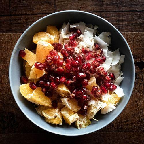 Start your day right Food Fruits Fresh Orange Healthy Eating Bowl Porridge Coconut Chips Pomegranate Breakfast Wooden Background