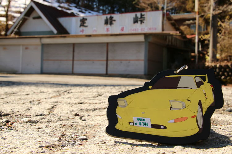 Anime Building Exterior Built Structure Car Close-up Day Guidance InitialD Japan Keisuke Land Vehicle Mode Of Transport Mountain Pass No People Outdoors Road Road Sign Rx7 Sign Street Takahashi Text Transportation Warning Sign Western Script