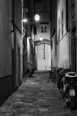 Florence Street By Night Illuminated No People Built Structure Architecture Day Street Outdoors Contrast Street Photography Travel Florence Florence Italy The Best City In The World Monochrome Black And White Shadows & Light Shadows Casting A Shadow Winter City Architecture Lifestyles Night Full Length Shadow