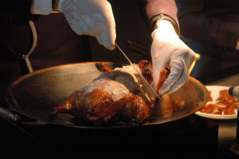 Food Food And Drink Human Hand Freshness Meat Preparation  Real People Hand Occupation Indoors  One Person Holding Preparing Food Human Body Part Working Roasted Close-up Unrecognizable Person Midsection Chef Duck Peking Duck Eyeem Philippines Eyeem Philippines Album Roast Duck
