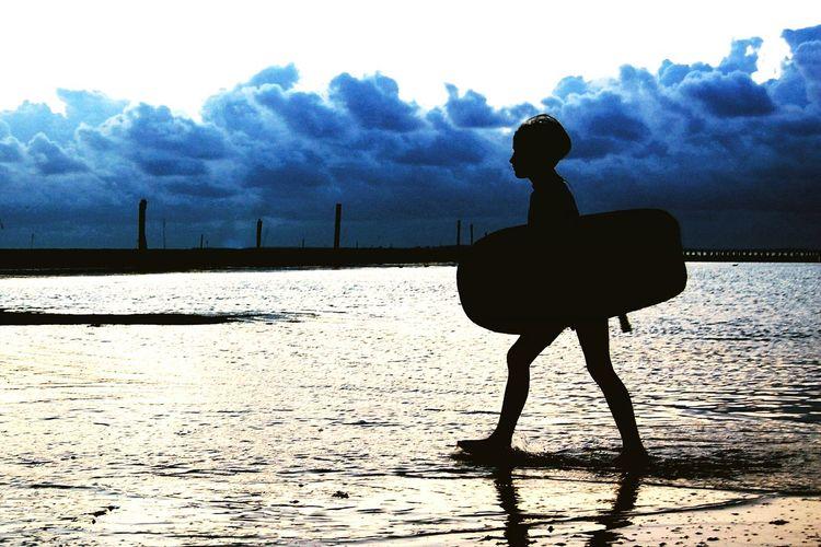 Low Tide Waddensea EyeEmNewHere Northsea Coast Bodyboard Surfboy Child Silhouette Performing Arts Event Sky Cloud - Sky Beach Surfer Coast Surfboard Surf Summer Exploratorium