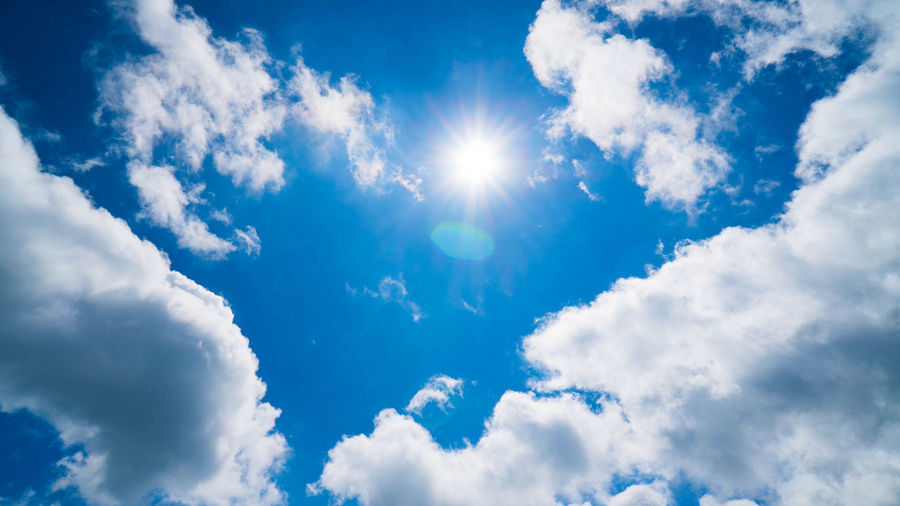 Backgrounds Beauty In Nature Blue Bright Brightly Lit Cloud - Sky Cloudscape Day Directly Below Environment Idyllic Lens Flare Low Angle View Meteorology Nature No People Outdoors Scenics - Nature Sky Sun Sunlight Tranquil Scene Tranquility White Color