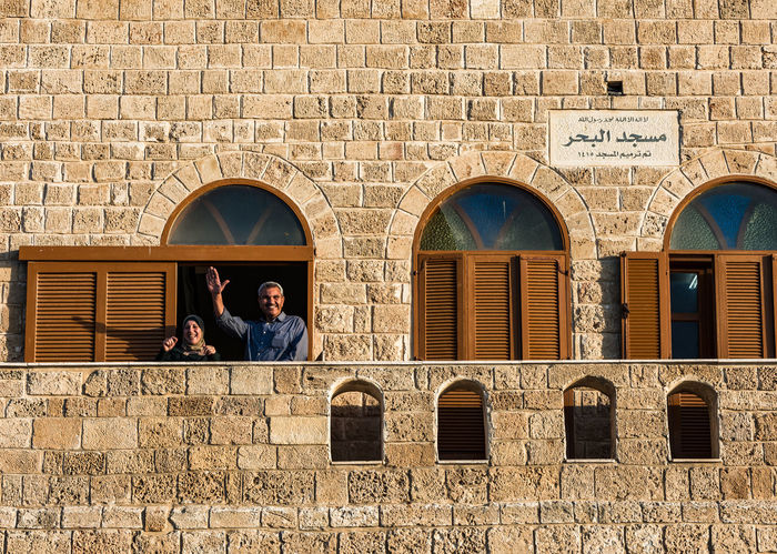 AlBaher mosque jaffa - some nice couple during a photowalk was happy to pose for us Arch Architecture Architecture Brick Wall Building Exterior Built Structure EyeEm Team History Jaffa Lifestyles Mosque People Real People Stone Material Street Photography Streetphotography The Street Photographer - 2017 EyeEm Awards Two People Window Windows The Week On EyeEm Stories From The City