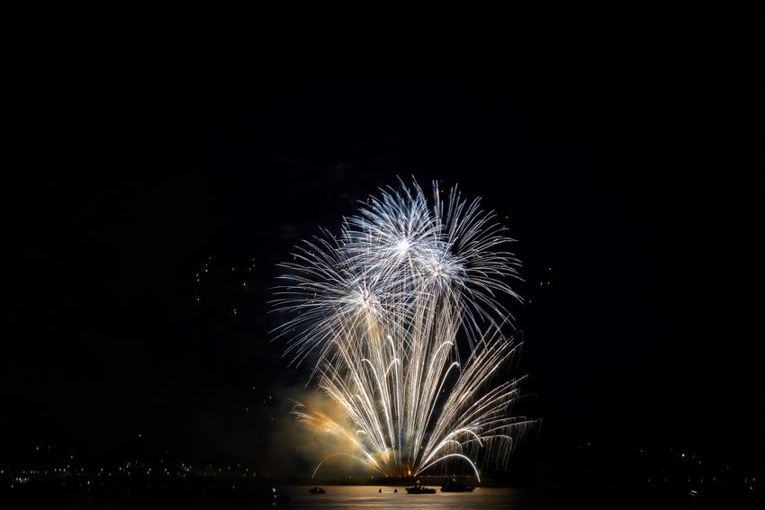 Arts Culture And Entertainment Blurred Motion Celebration Copy Space Event Exploding Firework Firework - Man Made Object Firework Display Glowing Illuminated Light Long Exposure Motion Nature Night No People Outdoors Sky Smoke - Physical Structure Sparks