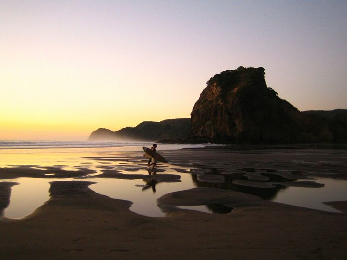 Surfers at Lion Rock Piha Beach NZ Sunset_collection Sea_collection