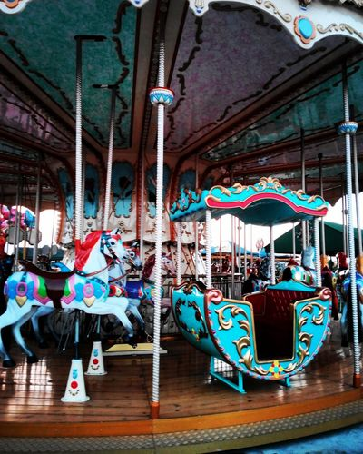 Multi Colored Hanging Arts Culture And Entertainment Day No People Outdoors Statue Carousel