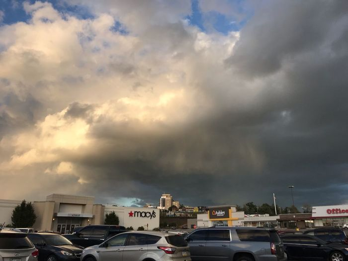 Storm Car Motor Vehicle Cloud - Sky Mode Of Transportation Transportation Land Vehicle Sky Architecture City Road Built Structure Nature Building Exterior Street No People Parking Lot Outdoors Building Traffic Text