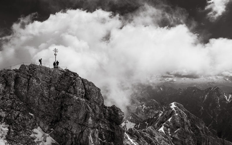 People at zugspitze against sky