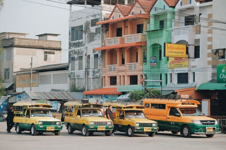 Cars on street by buildings in city