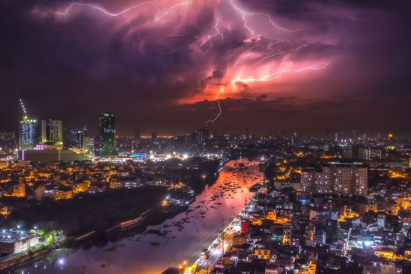 Wild lightning display over Pasig river, Philippines Urban Illuminated Built Structure Building Exterior Cityscape Sky Cloud - Sky Lightning High Angle View Building