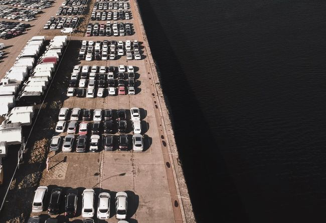 .\. DJI X Eyeem Areal View From Above  Dronephotography Drone  Bird's Eye View Habour Hamburg Check This Out Transportation Sunny Vehicles Parking Water Cars High Angle View In A Row Large Group Of Objects Wine No People Day Land Vehicle Outdoors