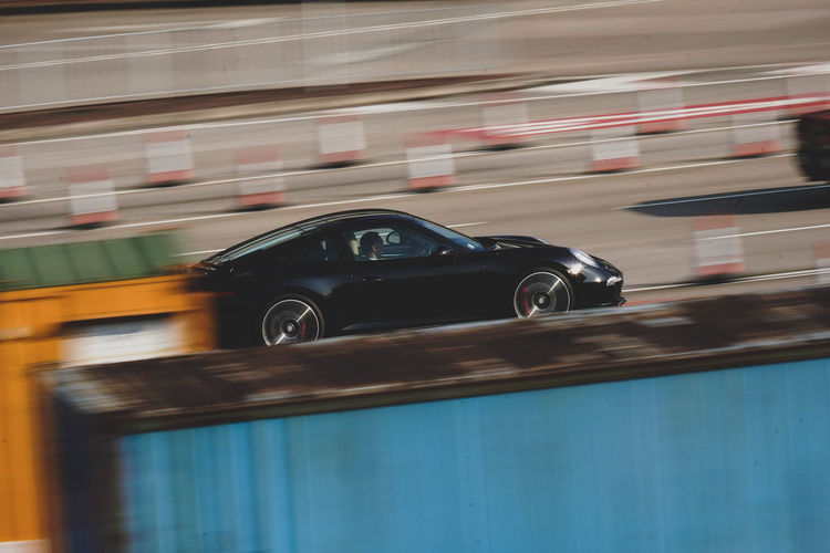 Blurred motion of car moving on road in city