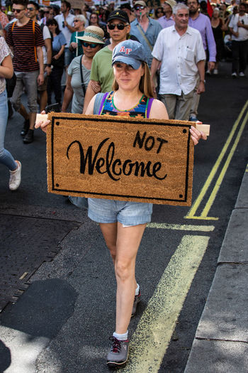 Not Welcome - Anti Trump March Malephotographerofthemonth Protest Anti Trump Anti Trump Protestor Dump Trump The Photojournalist - 2018 EyeEm Awards Women Men Low Section Text Politics And Government Large Group Of People Street Scene Democracy The Street Photographer - 2018 EyeEm Awards