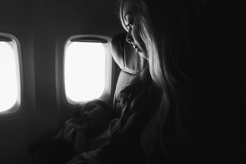 Girl Sleeping By Woman In Airplane