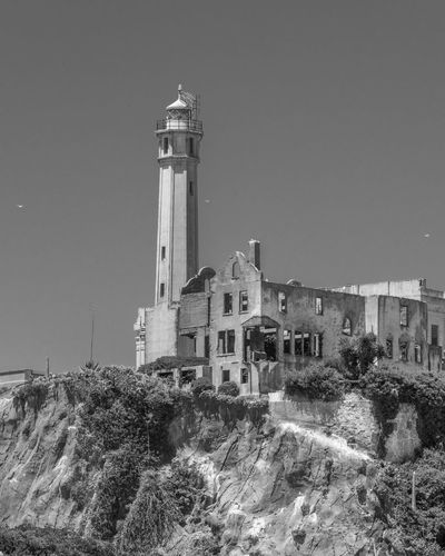 Alcatraz Blackandwhite Built Structure Architecture Building Exterior Building Sky Tower Nature No People Guidance Lighthouse History Travel Destinations Clear Sky The Past City Plant Outdoors Day Tree Land