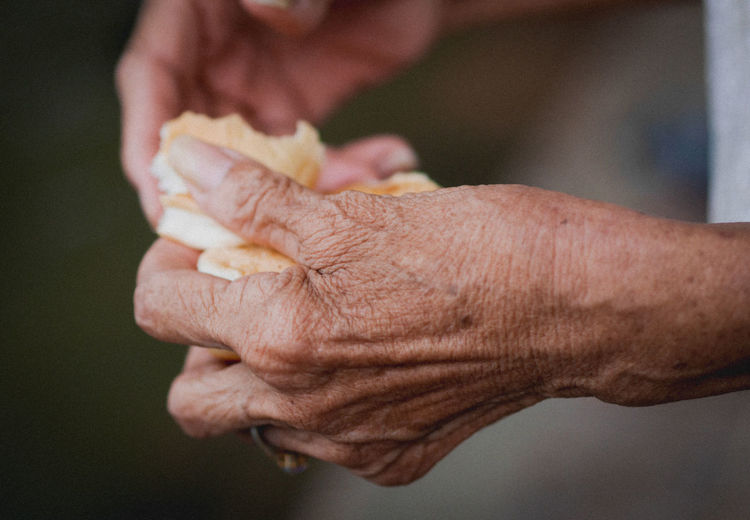 Close-up of hand holding food against blurred background