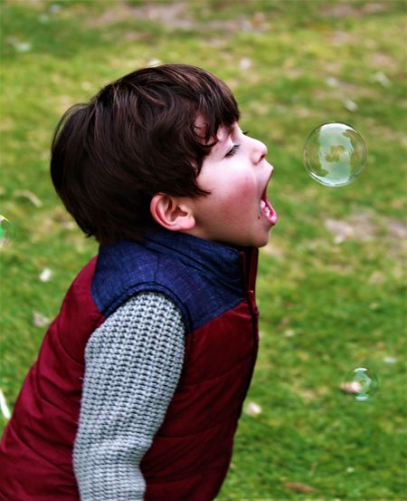 Close-up of boy playing with bubble