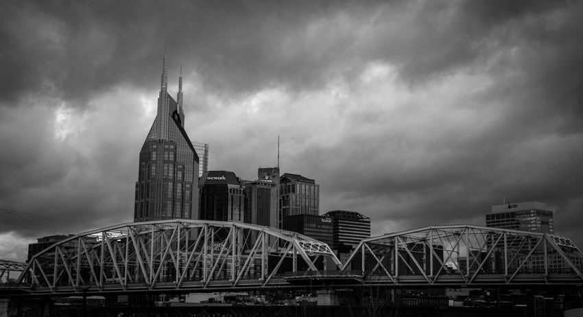 Downtown Nashville, Tennessee with some low clouds making for a dramatic look. Cityscape Dramatic Sky Nashville Architecture Arts Culture And Entertainment Blackandwhite Bridge - Man Made Structure Building Exterior Built Structure City Cityscape Cloud - Sky Day Illuminated Low Angle View Modern No People Outdoors Sky Skyscraper Travel Destinations Urban Skyline