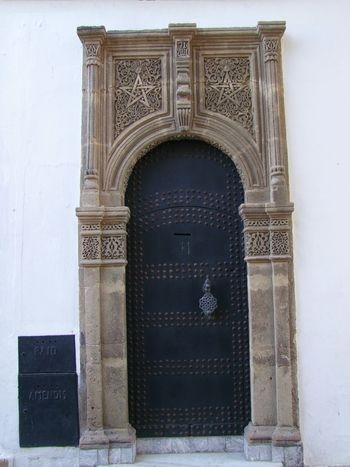 Moroccan Door in the Kasbah Arch Architecture Bas Relief Building Exterior Built Structure Carved Stonework Close-up Closed Composition Doorway Entrance Façade Full Frame Kasbah Moroccan Architecture Moroccan Style Morocco No People Old City Ornate Door Outdoor Photography Sunlight Tangier Tourist Attraction  Tourist Destination