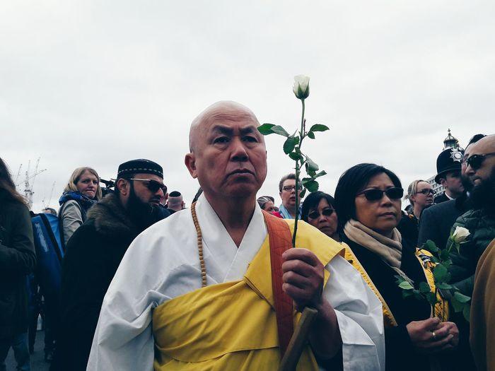 Friends standing on flower against sky