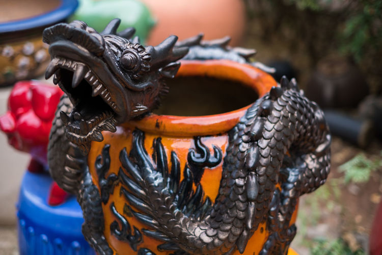 Pottery ceramic dragon. This is a work of art in clay sculpture. Traditional and ancient. Clay Ancient Antique Architecture Art Backgrounds Beautiful Ceramic Container Craft Culture Decoration Design Dragon Earthenware Glazed Object Old Ornament Pot Pottery Ratchaburi, Thailand Sculpture Statue Stone