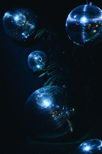 Close-up of illuminated christmas lights against black background