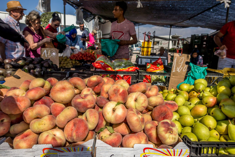 Market Food Food And Drink Healthy Eating Market Stall Freshness Fruit Retail  Wellbeing Business For Sale Incidental People Large Group Of Objects Real People Vegetable Small Business Day Buying Retail Display Outdoors Sale Roquetas De Mar Street Market SPAIN Almería