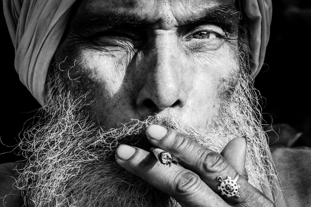 human finger, real people, one person, beard, portrait, human body part, looking at camera, bad habit, close-up, one man only, men, adults only, people, adult, human hand, only men, outdoors