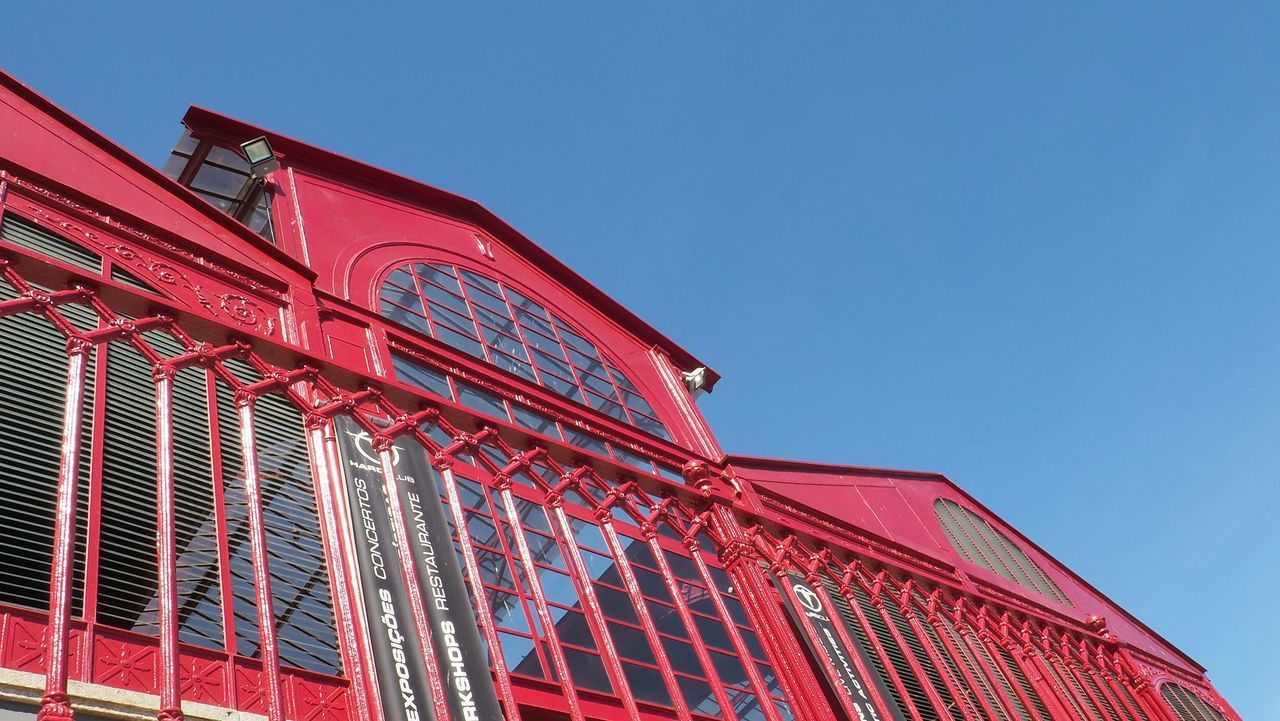 low angle view, red, architecture, building exterior, built structure, no people, outdoors, day, clear sky, blue, sky